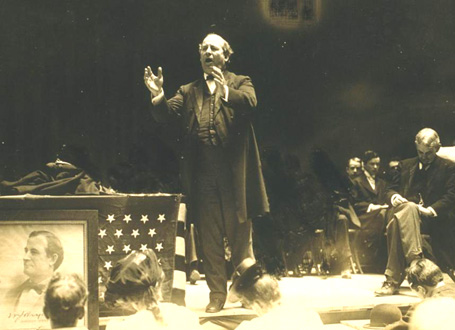 William Jennings Bryan communicating in 1908 (image via pastdaily.com).